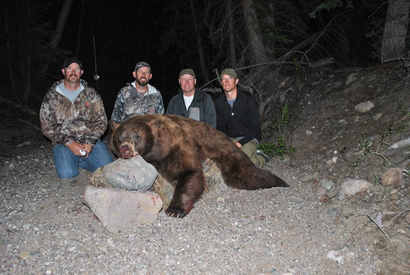 Great friends helping on a bear hunt