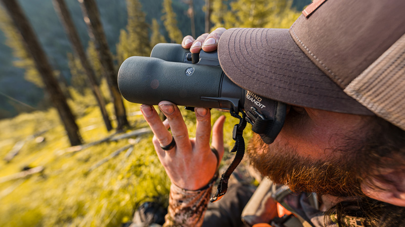 Handholding pair of Vortex Razor HD 12x50 binoculars