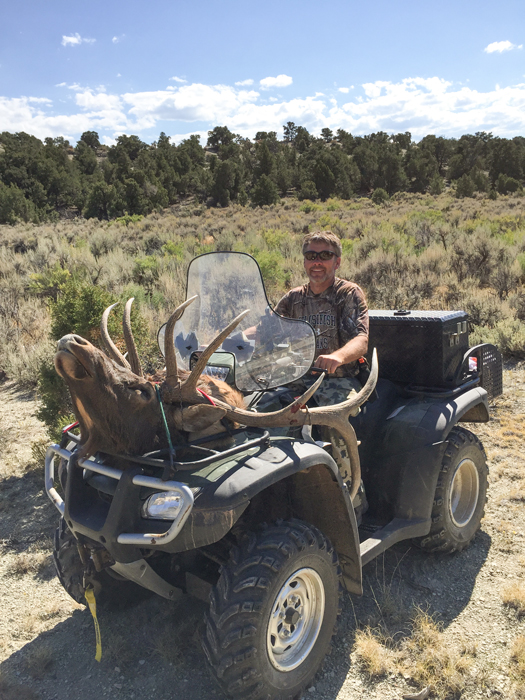 Hauling elk back on ATV