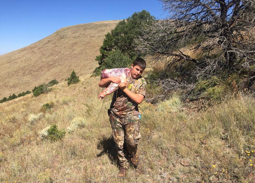 Hunter Agnetti packing out a bull elk quarter