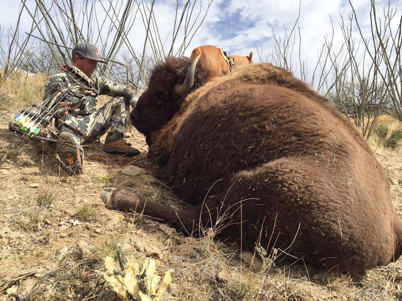Hunter Haynes taking in the moment after taking a bison with his bow
