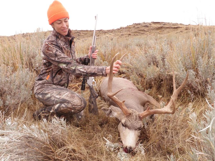 Lisa with a mule deer buck