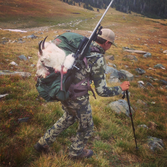John Bielak packing out his Colorado mountain goat