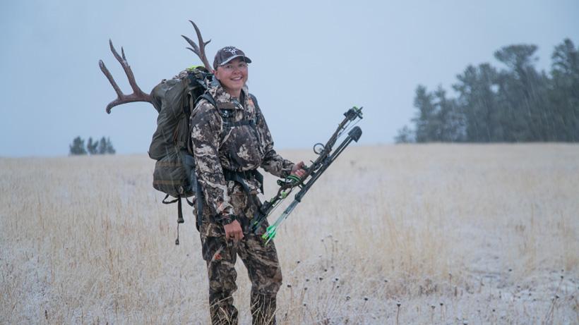 Jordan Budd packing out her mule deer