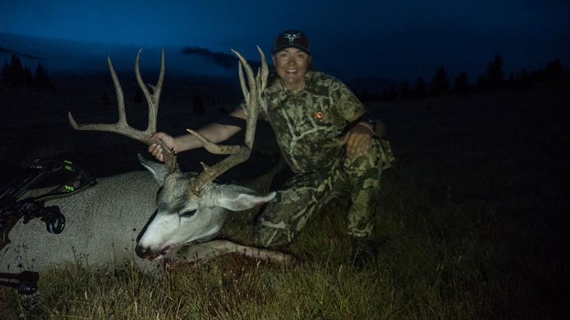Jordan Budd with her Wyoming mule deer buck