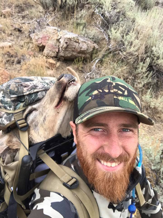 Justin Klement packing out mule deer