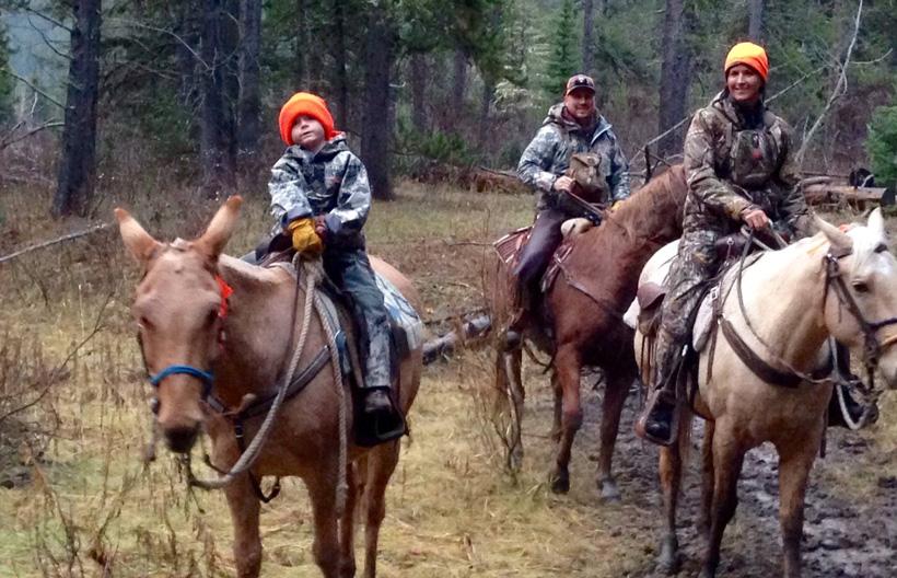 Kaydan riding Hondo the mule