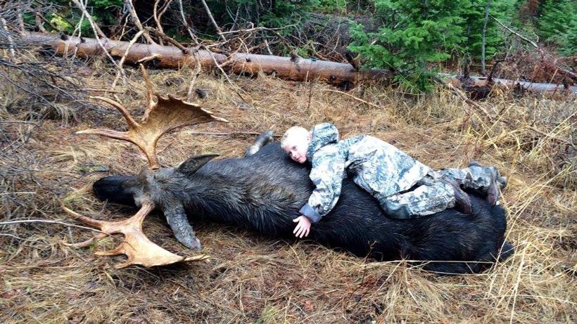 Kayden hugging the Wyoming bull moose