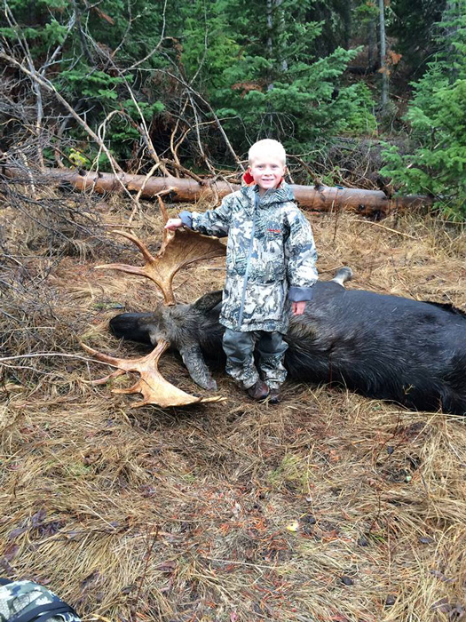 Kayden with the bull moose
