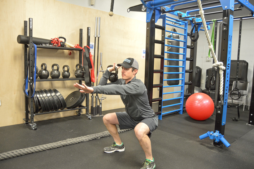 Kettlebell swing and squat workout for hunting