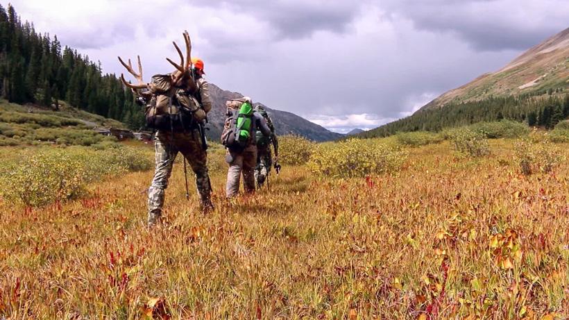Kevin Clerkin packing out his mule deer buck