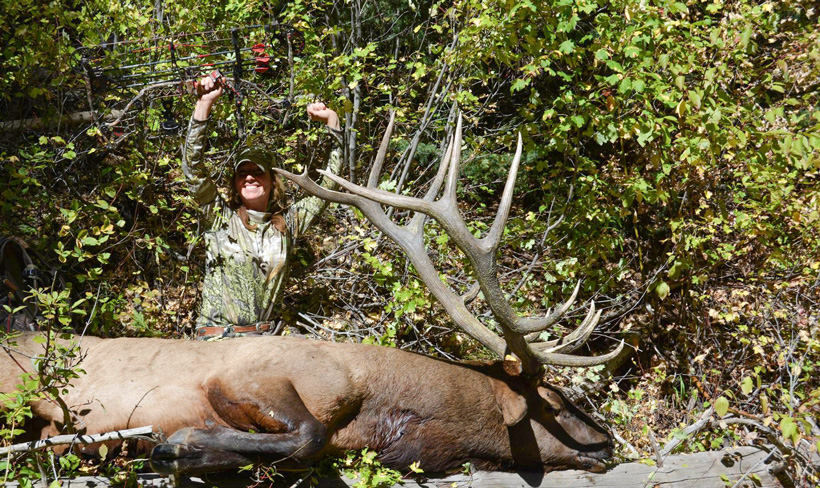 Kim Mills celebrating after taking an archery bull elk