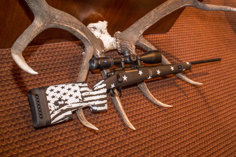 Kody Smith Outlaw Custom Gun on an elk rack