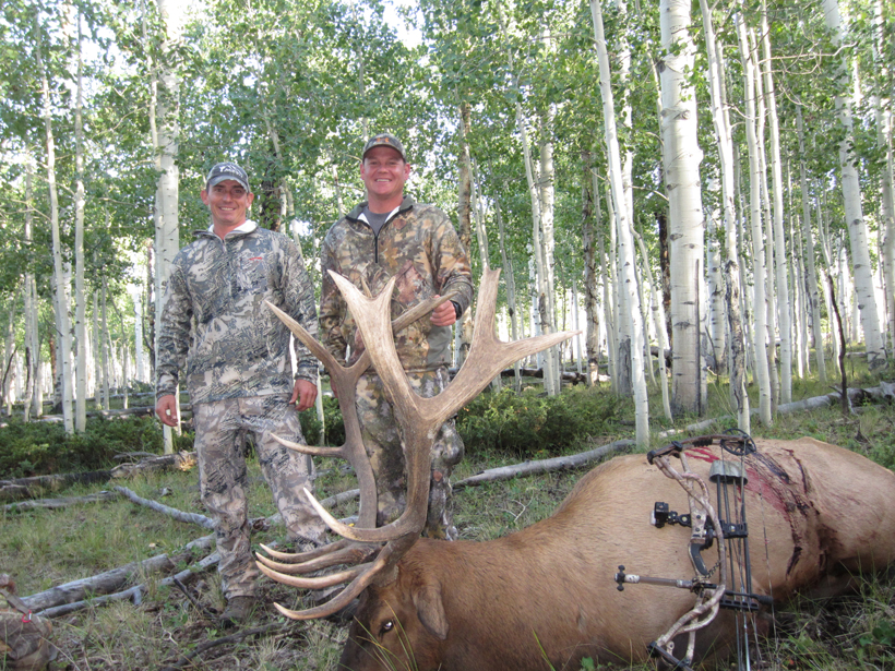 Landon Floyd and his friend with his Utah archery bull