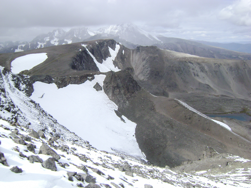 Large snowfields in mountain goat country
