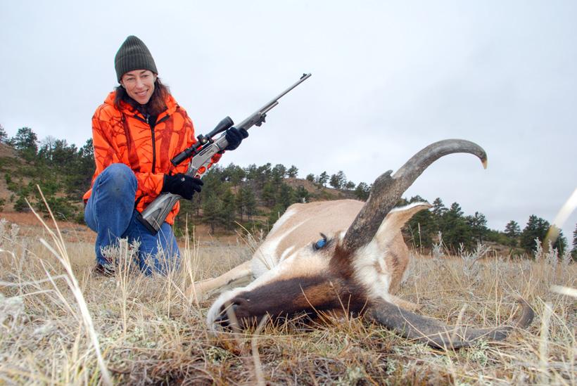 Lisa Ballard admiring her antelope buck