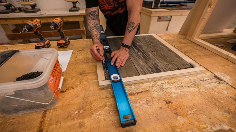 Marking where to burn the barn wood