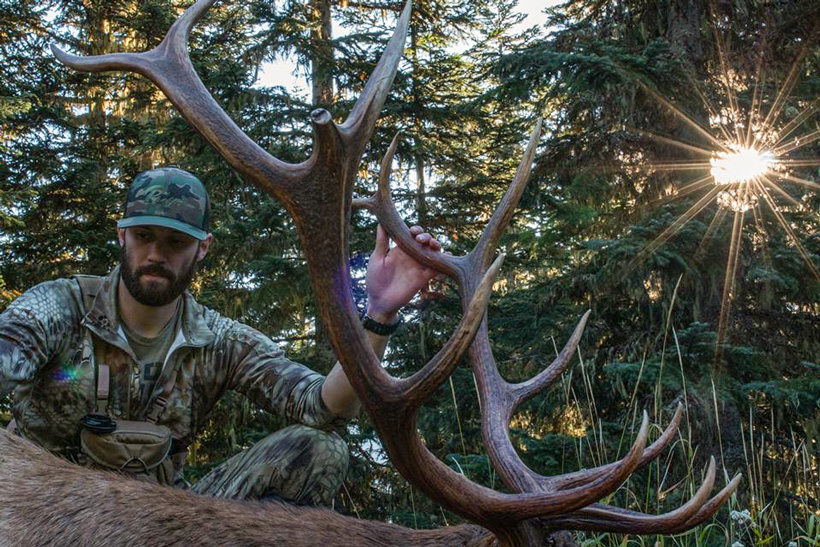 Nick Schmit soaking up the moment after taking his bull elk