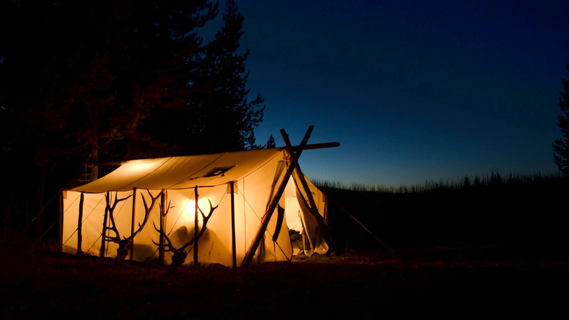 Night photo of a Davis Tent and Awning wall tent