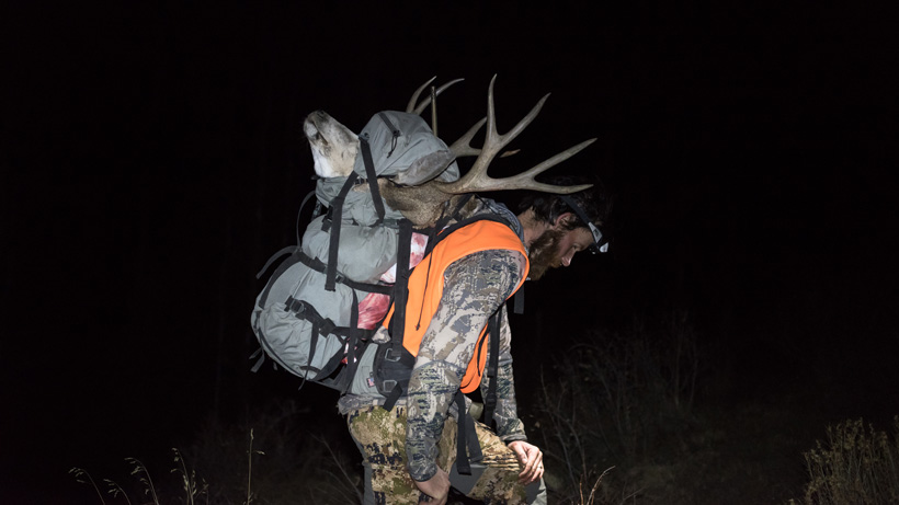 Packing out Colorado mule deer in Stone Glacier backpack