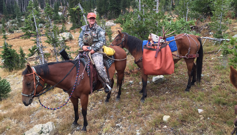 Packing out a mule deer on horseback