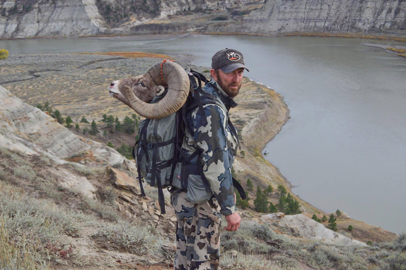 Pete Enrooth packing out his Montana missouri river breaks bighorn sheep