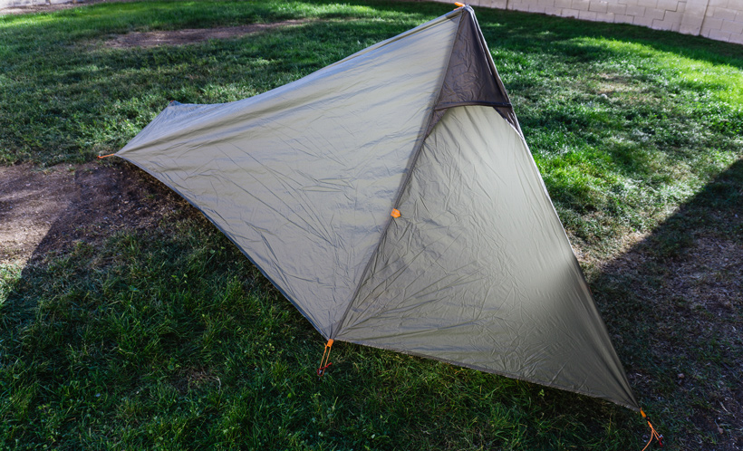 Using trekking poles for setting up a tent