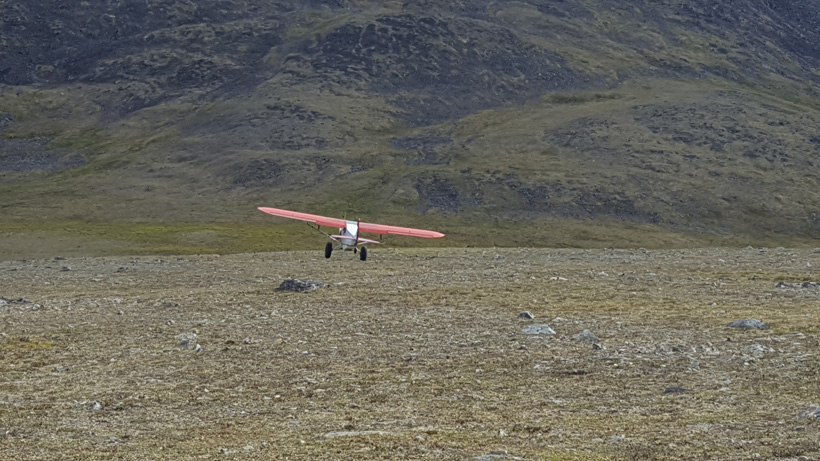 Plane landing to pick up hunting gear