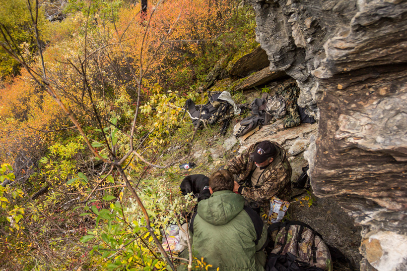 Preparing lunch while hunting near a rock cliff