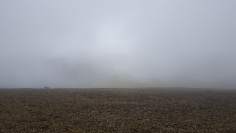 Rain and fogged in while hunting dall sheep