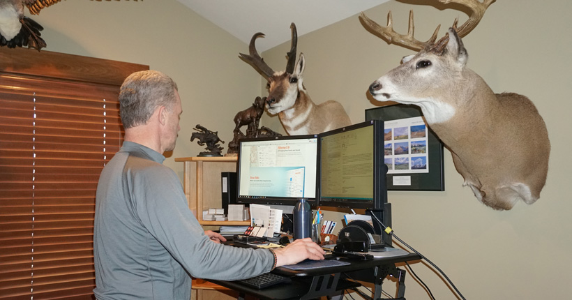 Randy Newberg doing some computer scouting for an elk hunt