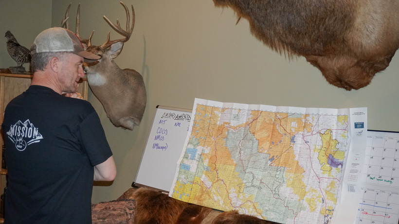 Randy Newberg finding hunting spots on a map