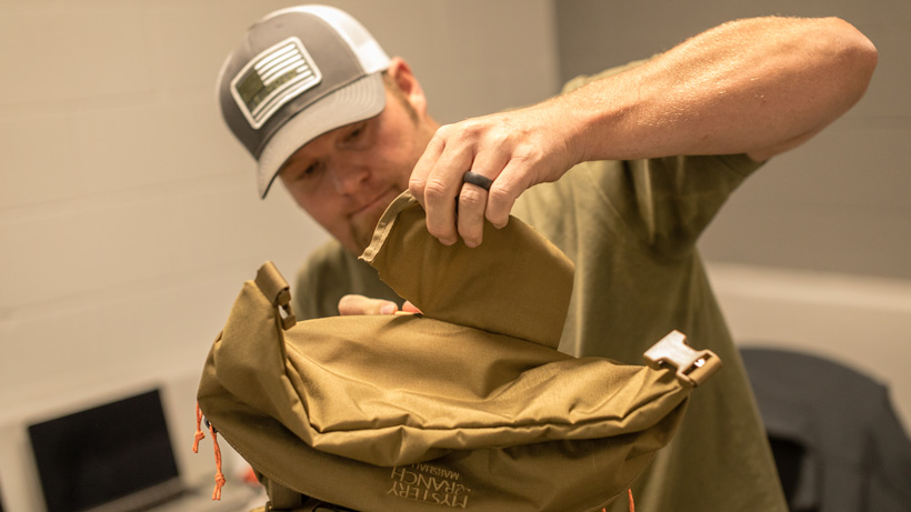 Removing fabric on top lid of Mystery Ranch Marshall backpack