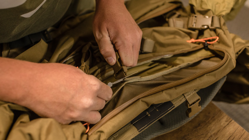 Removing main backpack compartment buckles