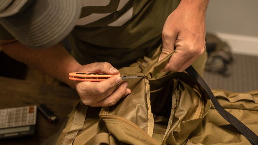 Removing sleeping bag compression strap