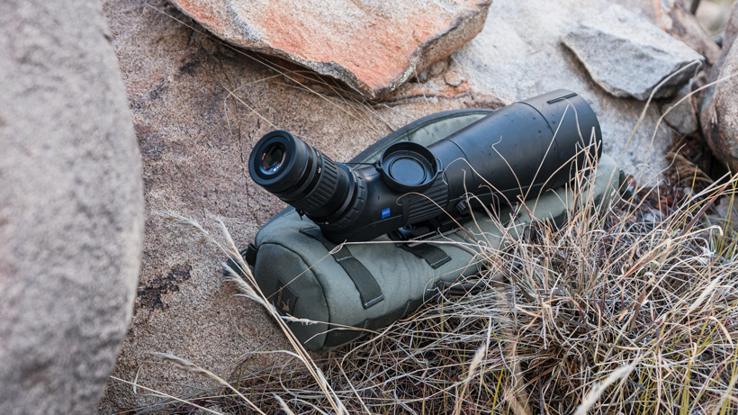 Resting spotting scope on protective padding