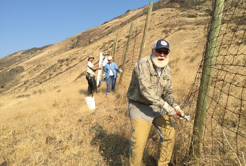 Rocky Mountain Elk Foundation members on a fence removal project