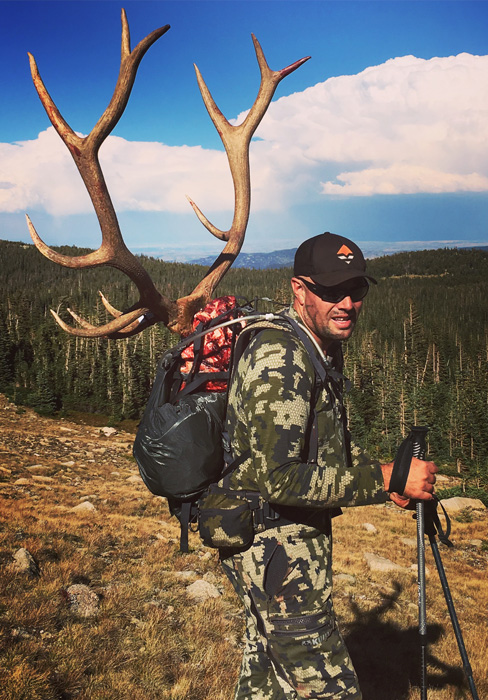 Ryan McConnell packing out his Colorado archery bull elk