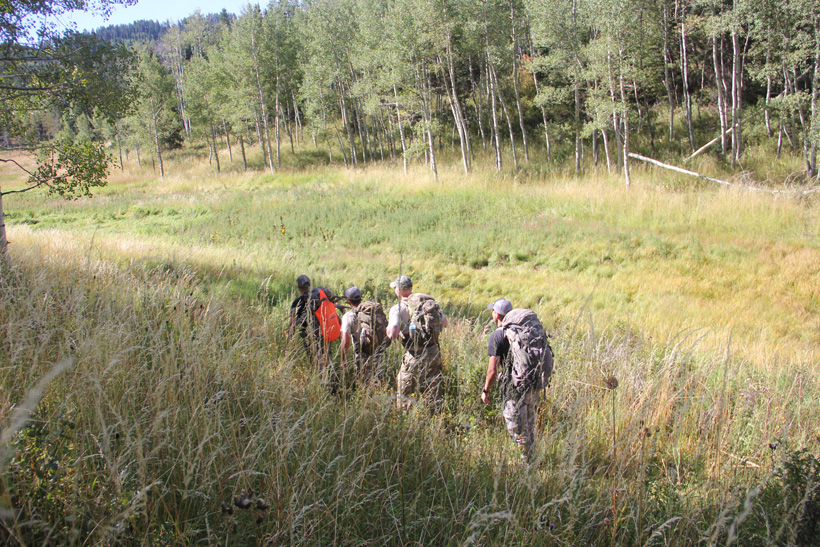 Shane Southwick and friends packing out an elk