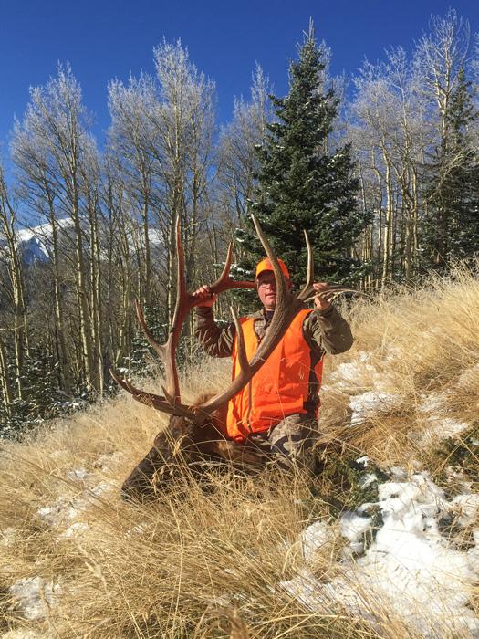Shey Cowan with his 2015 Colorado bull elk vertical photo