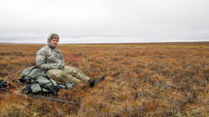 Sitting out another Alaska rain storm while hunting caribou