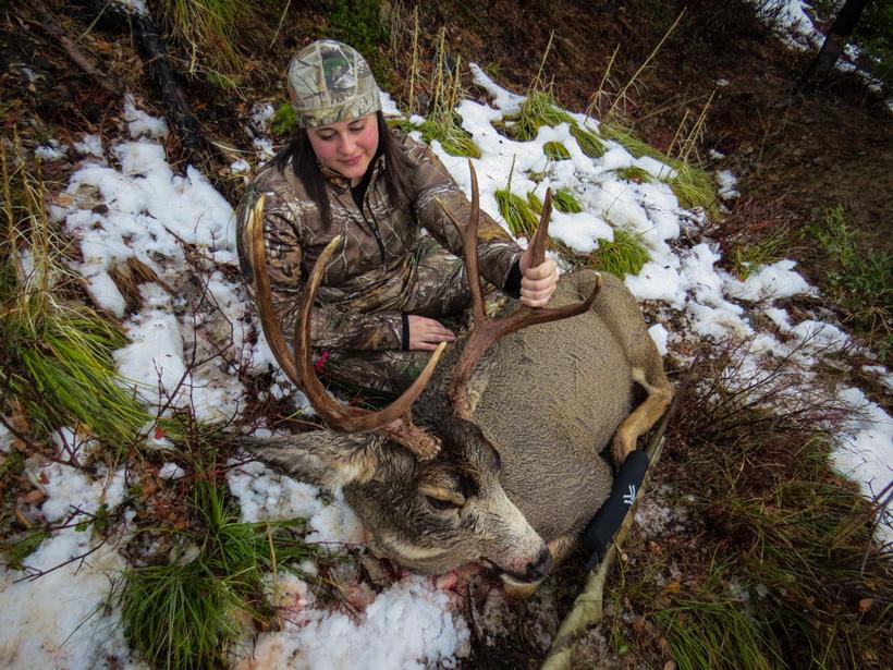Stephanie Barnett admiring her Montana mule deer