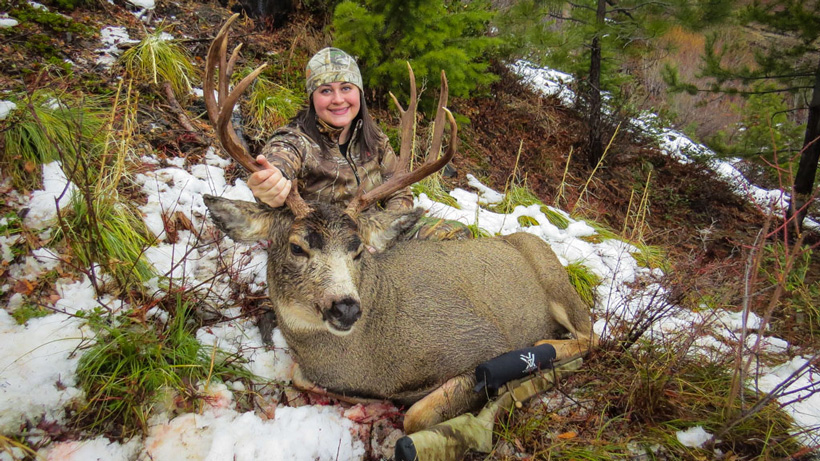 Stephanie Barnett with her Montana mule deer buck angled view