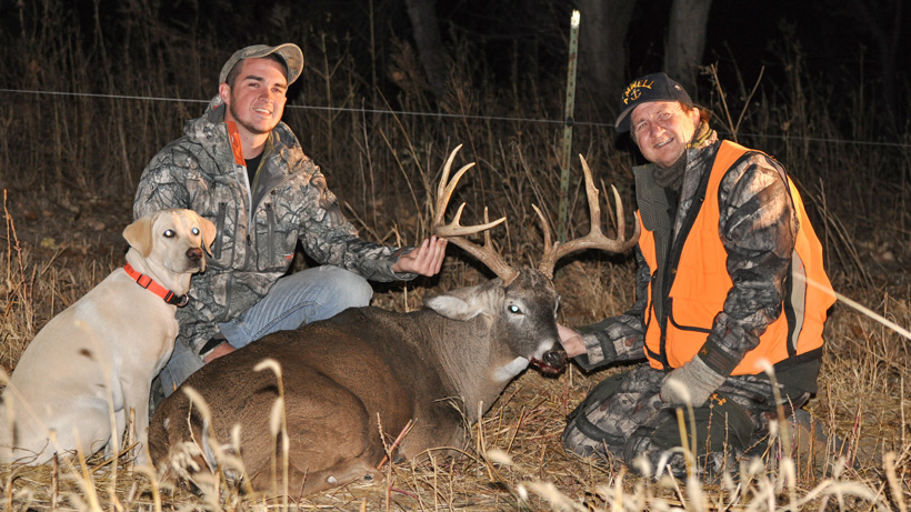 Stephen Spurlock and his dad with a whitetail buck