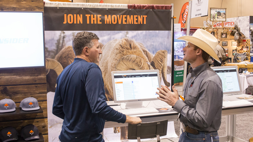 Talking with customers at a hunting trade show