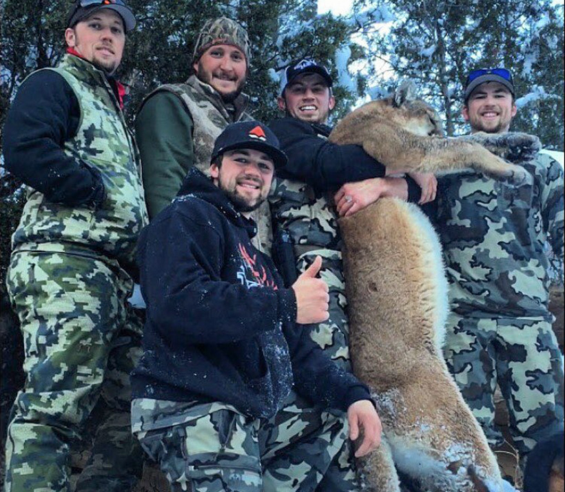 Tanner Dolbec and the group with his mountain lion
