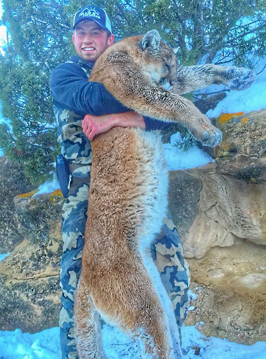 Tanner Dolbec with his Colorado mountain lion