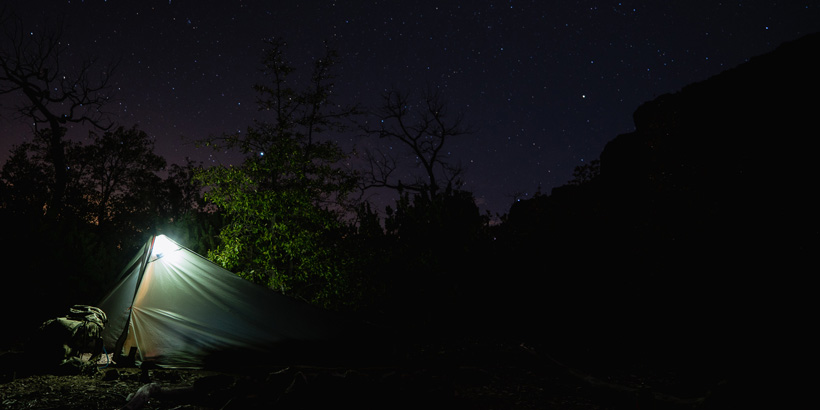 Tent at night in mountains