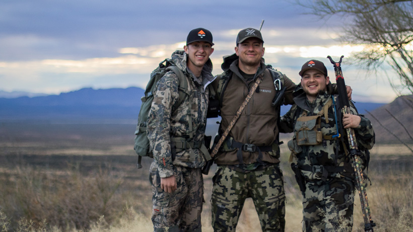 The group of friends all smiles after a Coues deer hunt
