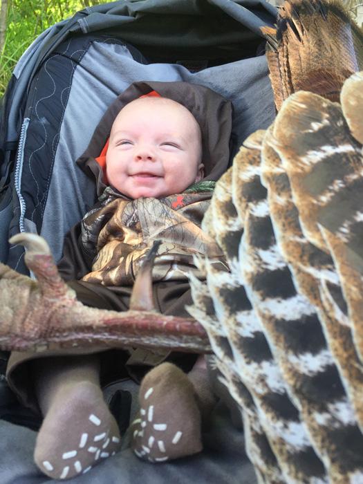Tiffany and Lee Lakosky's son Cameron with a turkey
